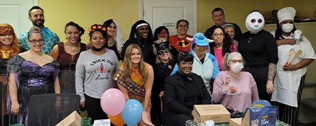 Dental team members wearing costumes