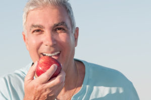 man happy with dental implants in Lansing